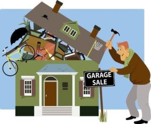 A picture of a man putting up a garage sale sign in front of a house, overrun with junk.